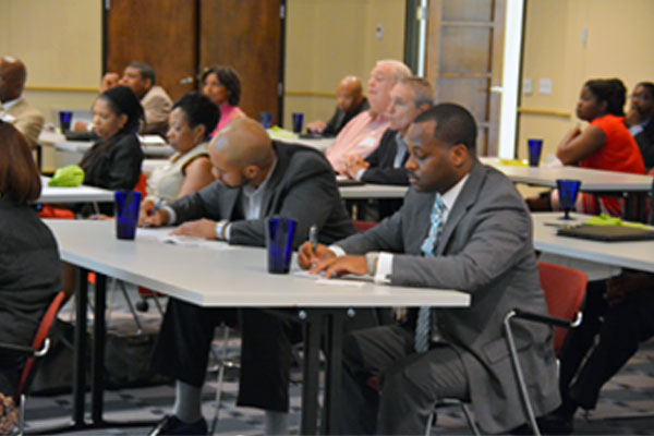 image of Charlotte Mecklenburg BLACK CHAMBER of Commerce member working at meeting.